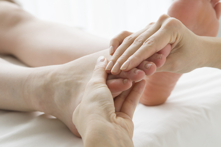 hold ups: Woman to a foot massage Stock Photo
