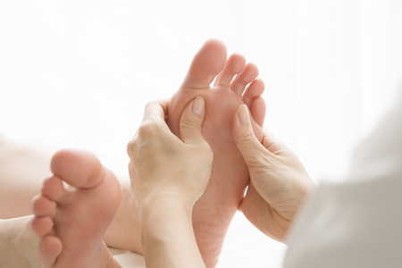adult foot: Woman to a foot massage Stock Photo