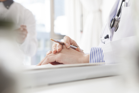 physicians: Hand of obstetricians