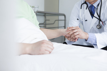 Hold the hand of the patient Stock Photo - 51656362