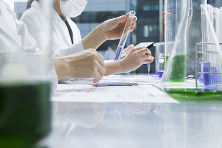 researchers: Women researchers are experimenting with a test tube