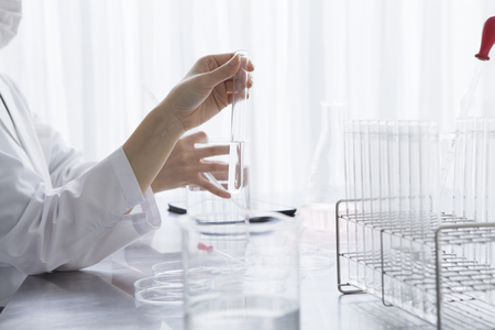 researchers: Women researchers are taking to hand the test tube Stock Photo