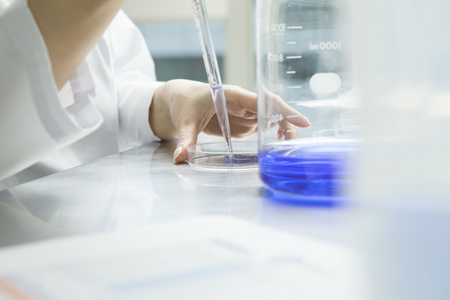 Women researchers have put the liquid in a Petri dish with dropper