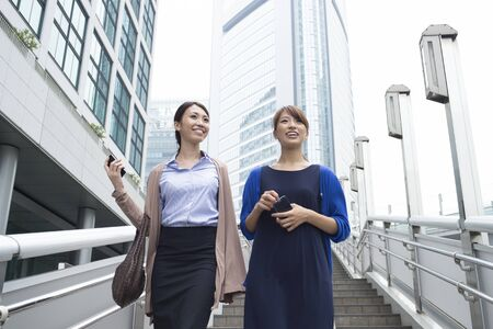 casual office: Women working in the city Stock Photo