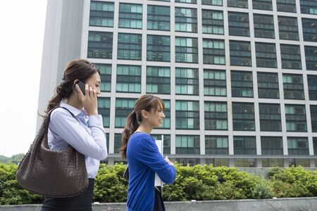asian business man: Female company employee in the office district Stock Photo