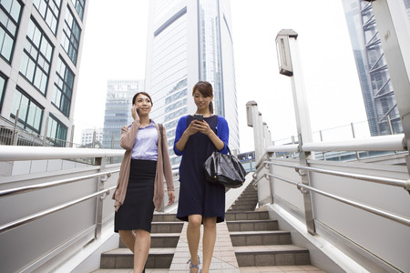Women working in the city Stock Photo