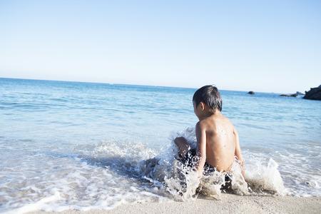 urban parenting: Children play on the beach