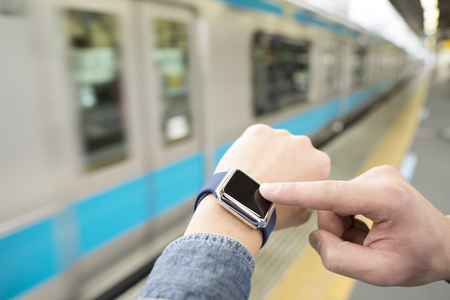 open business: A man to use a smart watch at the station.