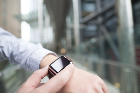 Use the smart watch the front of the building. Stock Photo - 56240989