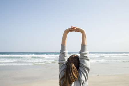 Woman to stretch on the beach