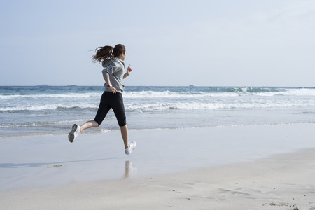 Run the seaside, wearing black leggings women