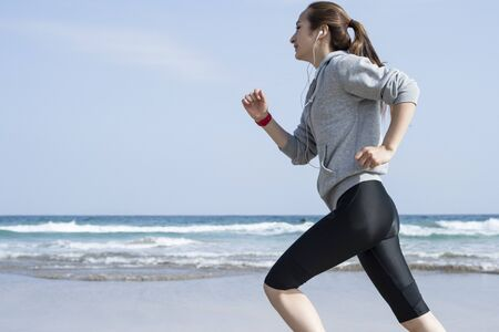 Run the seaside, wearing black leggings women