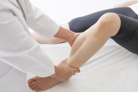 Tired of the day, Lets rest on the same day. Loosen the calf of tension. Stock Photo