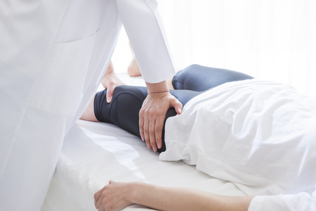relax massage: After work of women undergoing a thigh muscle massage. A reward of one day, the best relax.