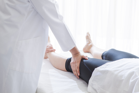 After work of women undergoing a thigh muscle massage. Stock Photo - 56246665