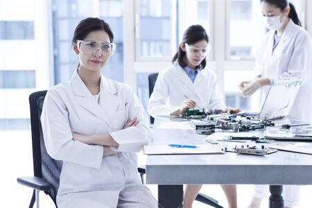 3 people: 3 people of genius female scientist wearing a white coat. Stock Photo