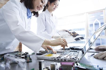 bata blanca: 3 people of genius female scientist wearing a white coat. Foto de archivo