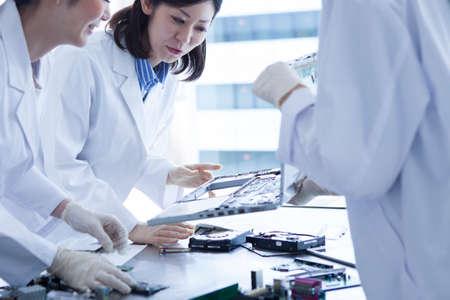 white coat: 3 people of genius female scientist wearing a white coat. Stock Photo