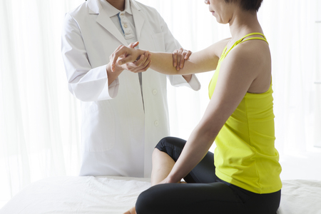 feels good: Therapist doing rehabilitation massage with hands on female...