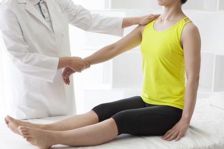 shin bone: Therapist doing rehabilitation massage with hands on female...