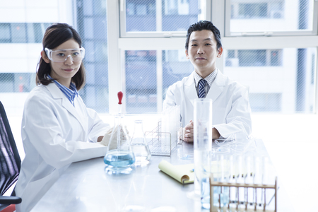 Two young researchers at work. Stockfoto