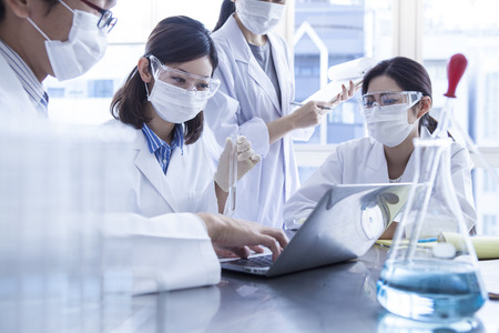 experiments: Scientists to the meeting gathered in the lab. Stock Photo