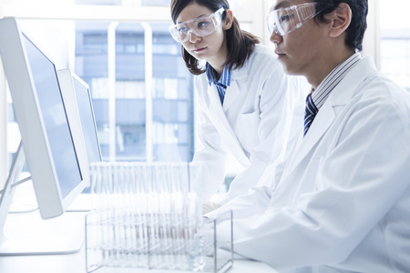 Scientists to the meeting gathered in the lab. Stock Photo