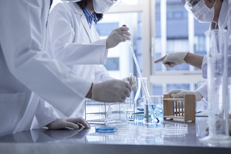 Science students working with chemicals in the lab at the university.