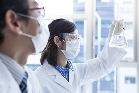 Biology lab technicians at work.