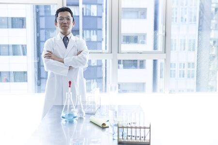 Scientists stand by the window.