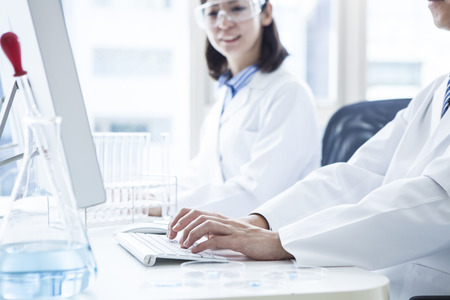 computer science class: Two scientists and a personal computer and windows. Stock Photo