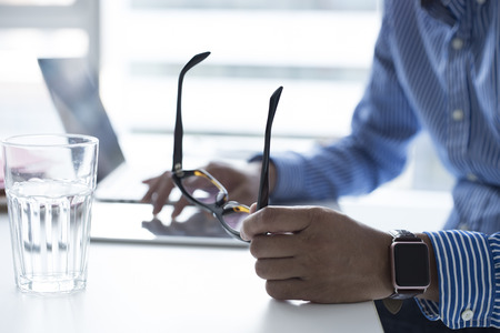 Businessman using smart tablet.