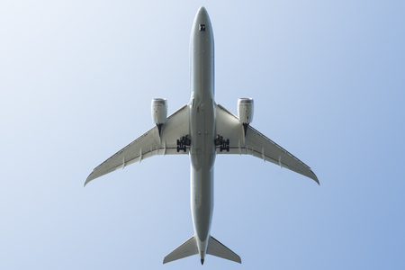 aerial photograph: A picture of an airplane from directly below.