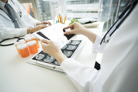 A portrait photo of a doctor working.