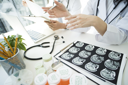 A desk with a lot of medicine bottles on it. Stock Photo