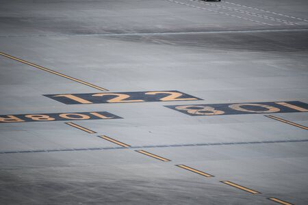 stiff: Numbers written in the airport.