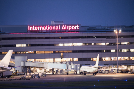 An airport illuminated by the light of the night.