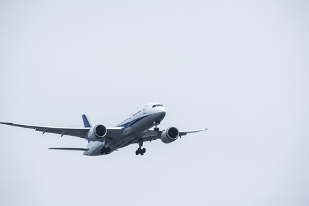 An airplane flying elegantly in the sky. Stock Photo