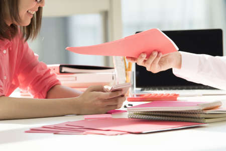 bisiness: The businessman hands over the document. Stock Photo