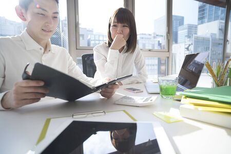 bisiness: They consult while watching documents. Stock Photo