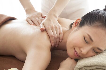 Close-up of a woman receiving a massage in a prone position.
