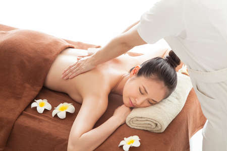 Beautiful woman receiving massage with beauty treatment. Stock Photo