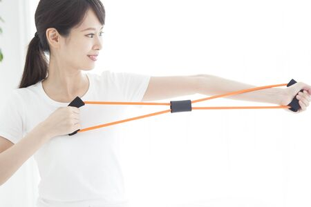 A woman who exercises strength training in chiropractic.