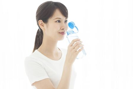 A woman who supplies hydration at chiropractic.