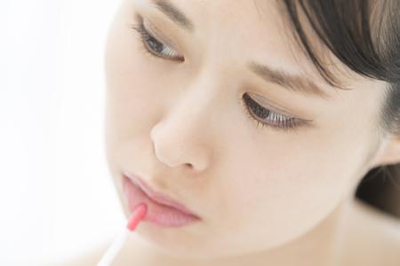 Lip-gloss On Lip To Make Asian Girl Beautiful