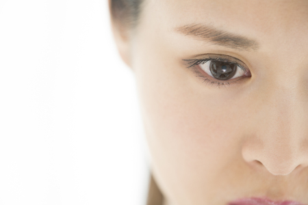 Asian model eye close-up. Selective focus.