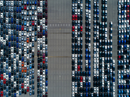 Aerial shots of cars before mass sales.