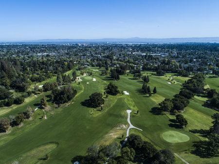 Aerial photograph of golf course and distant mountains. 写真素材