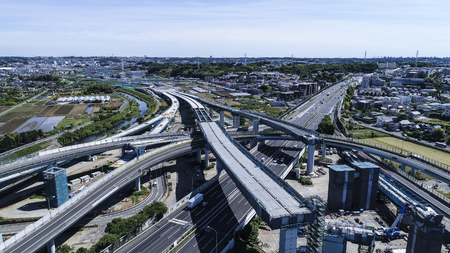 An aerial photograph of a highway under construction. Dynamic view.