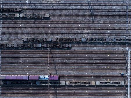 Aerial shooting of old train garage and container transport vehicles. Archivio Fotografico